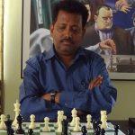 Manik Dhore playing chess