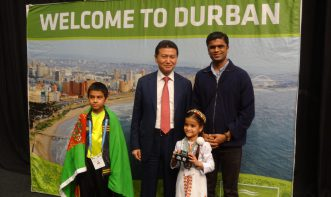 Kapil Lohana and his students holding prize at Durban