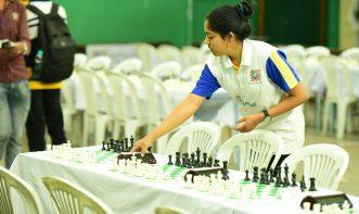 Gargi sane arranging Chess setup