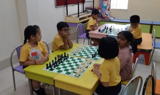 school student playing chess