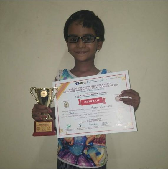Parthi Vichwekar holding trophy and certificate