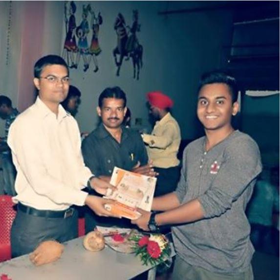 Satyam Warude receiving prize in chess tournament