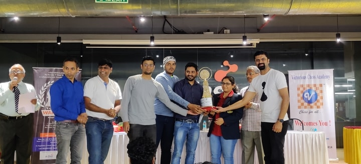 Best Woman player Akshata Shah of Infosys receiving his trophy in war of wits tournament
