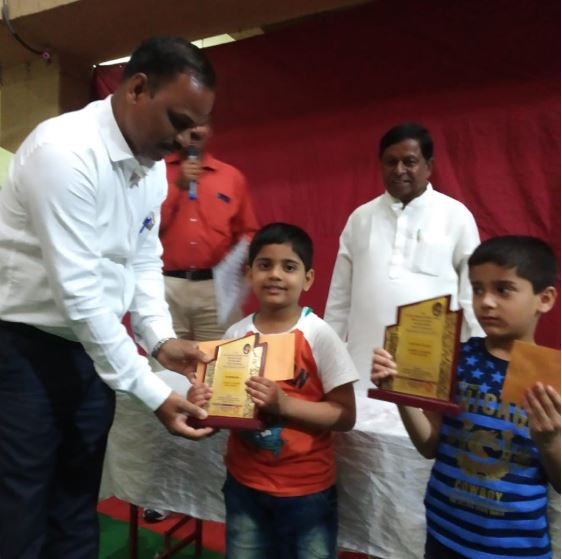 Vedant kale receiving Trophy after wining Under 6 category of One day Rapid Chess Tournament at Khadki.